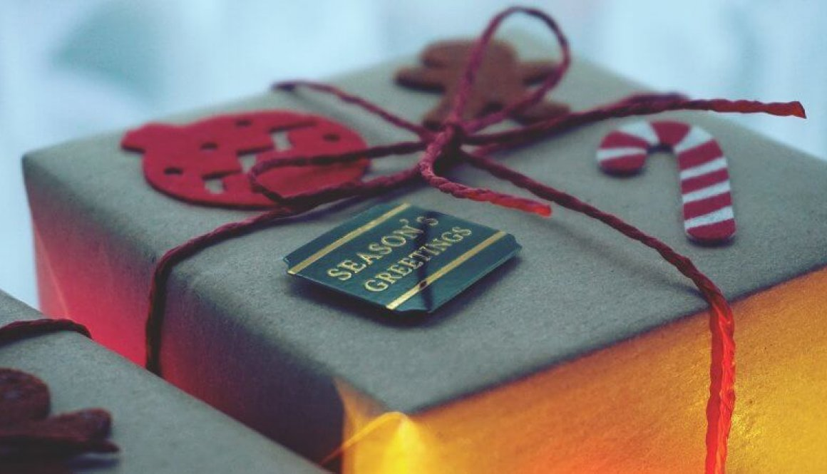close-up-photo-of-a-gift-box-wrapped-with-red-string-1661951